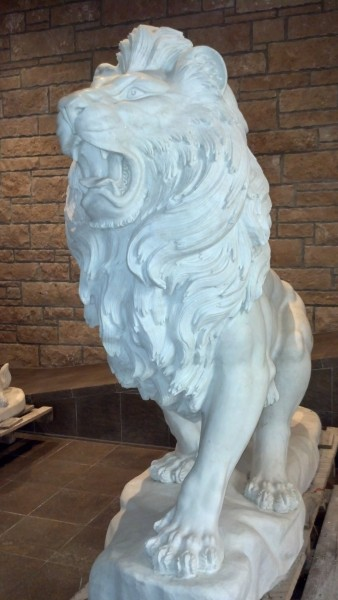 One of the five marble lions, and they did not seem like they were modeled after tame lions. I did in fact see a wardrobe in the storage area... one wonders...