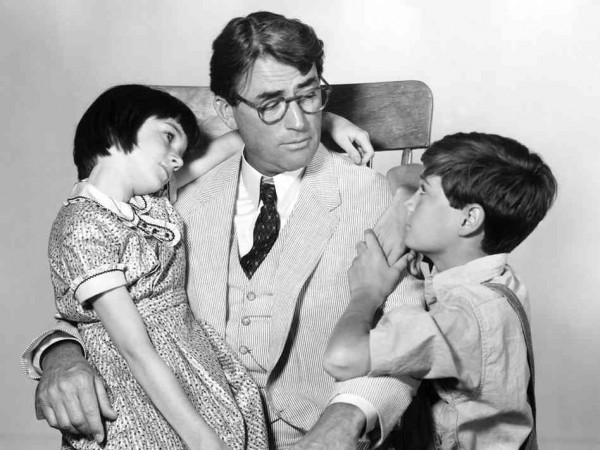 Gregory Peck as Atticus Finch with movie kids Scout and Jem.